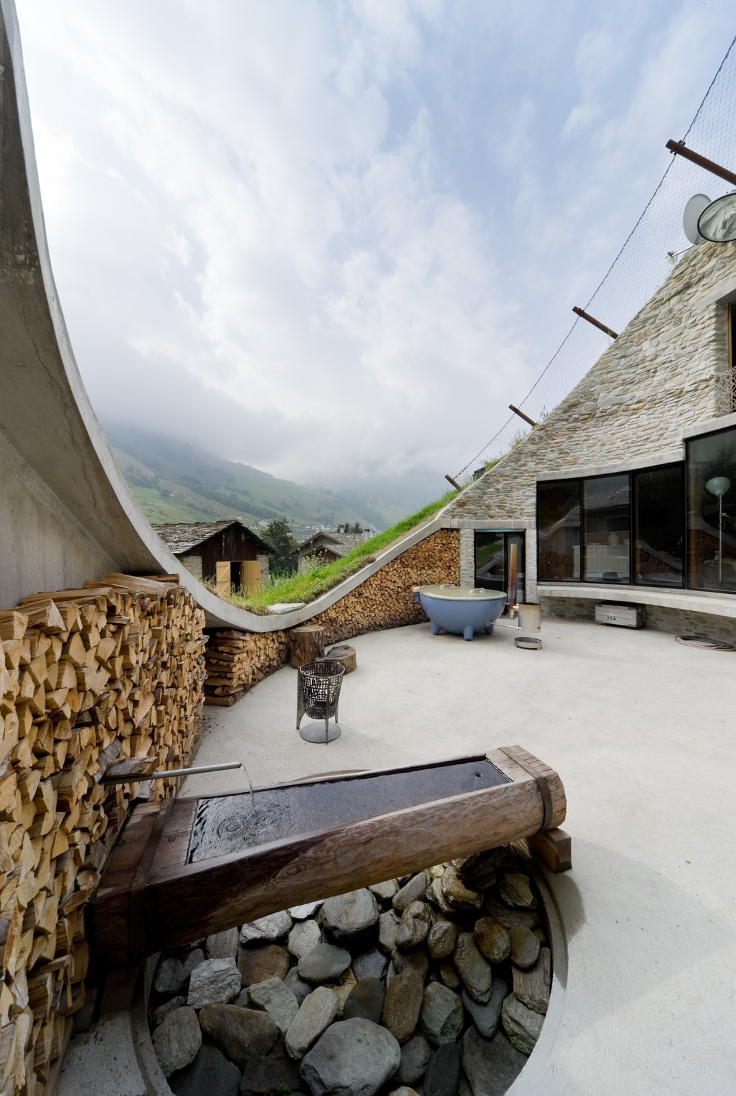 Outdoor, Concrete Patio, Porch, Deck, and Trees  Best Photos from Stay in a Swiss Vacation Home That's Literally Inside a Mountain