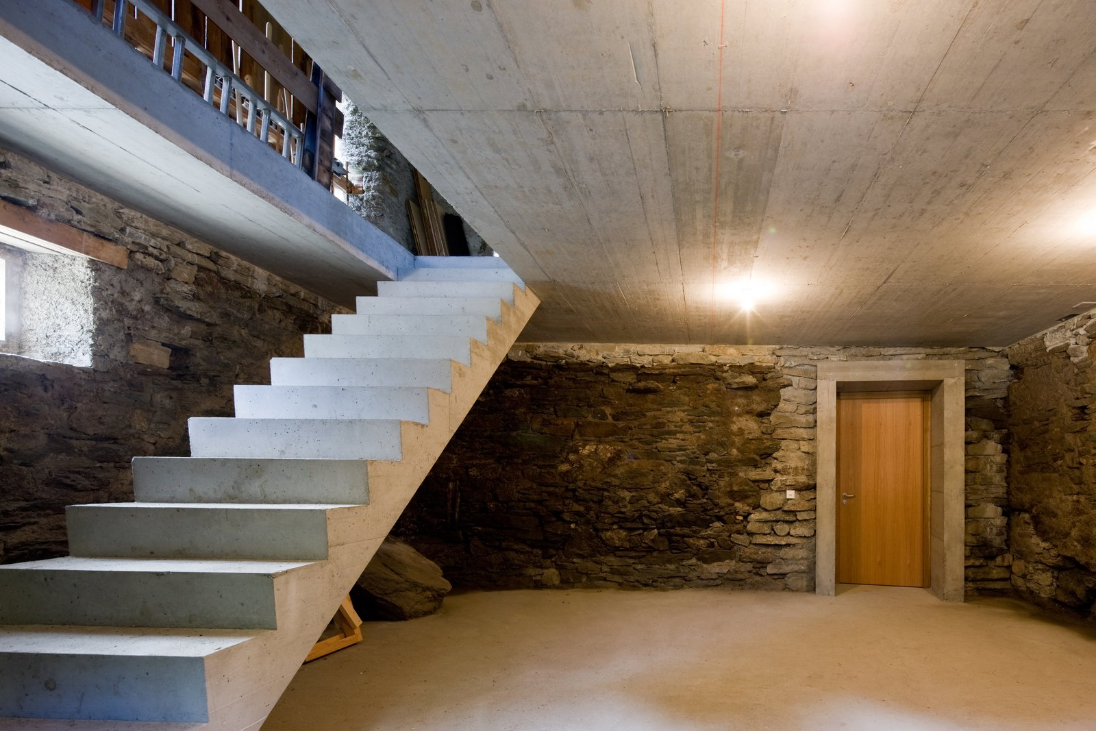 Staircase and Concrete Tread  Photo 8 of 13 in Stay in a Swiss Vacation Home That's Literally Inside a Mountain