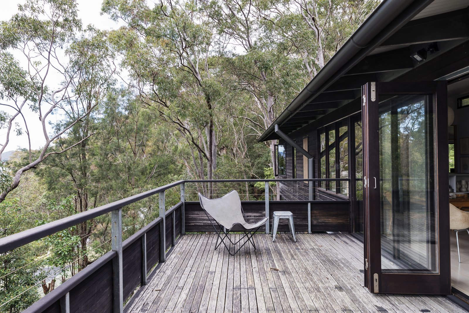Tagged: Outdoor, Large Patio, Porch, Deck, Wood Patio, Porch, Deck, and Trees.  Photo 5 of 13 in Stay in a Riverside Vacation Home That Embraces the Australian Bush