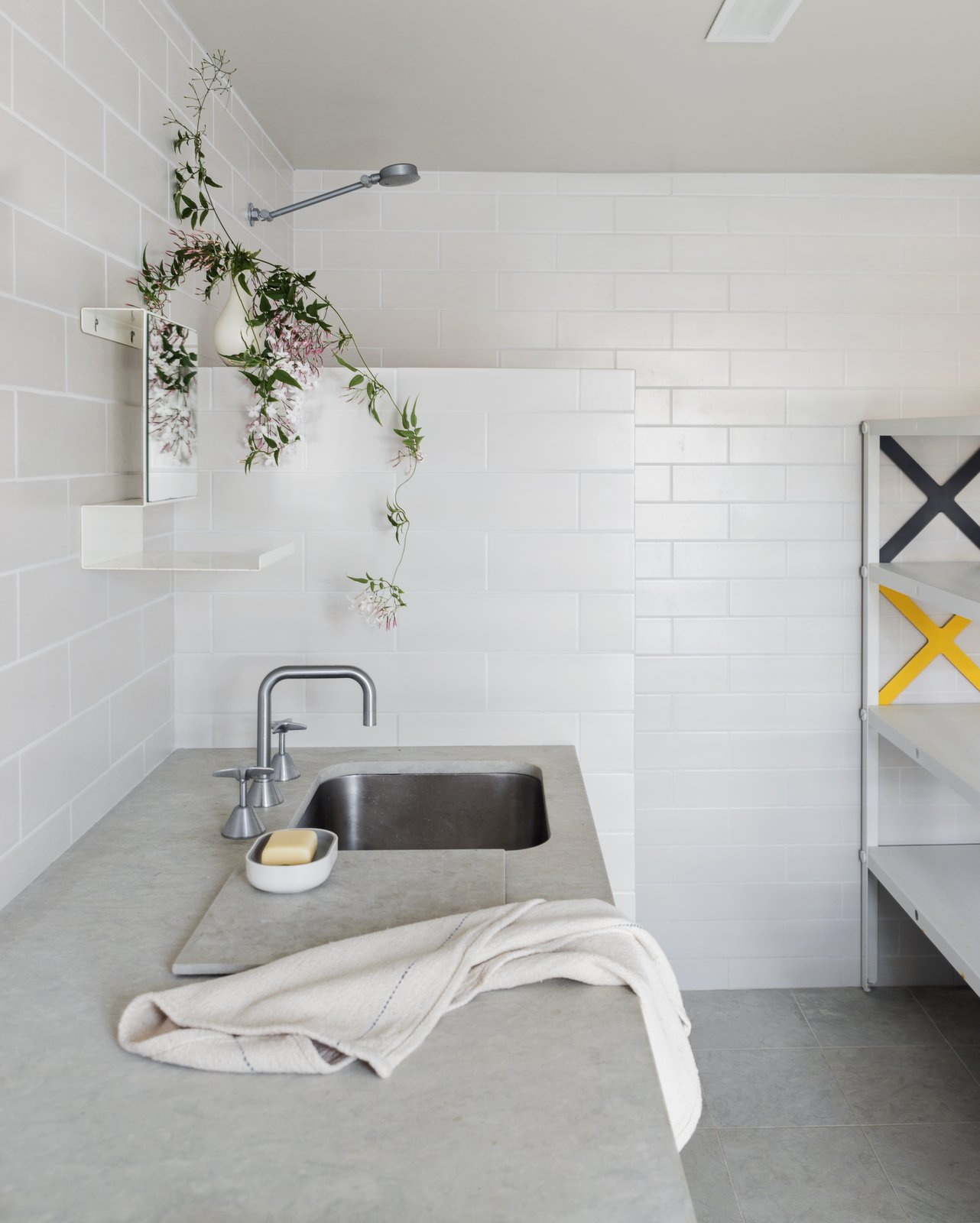 Concrete Counter, Bath Room, Concrete Floor, Open Shower, Undermount Sink, Subway Tile Wall, and Ceramic Tile Wall  Photo 10 of 13 in Stay in a Riverside Vacation Home That Embraces the Australian Bush