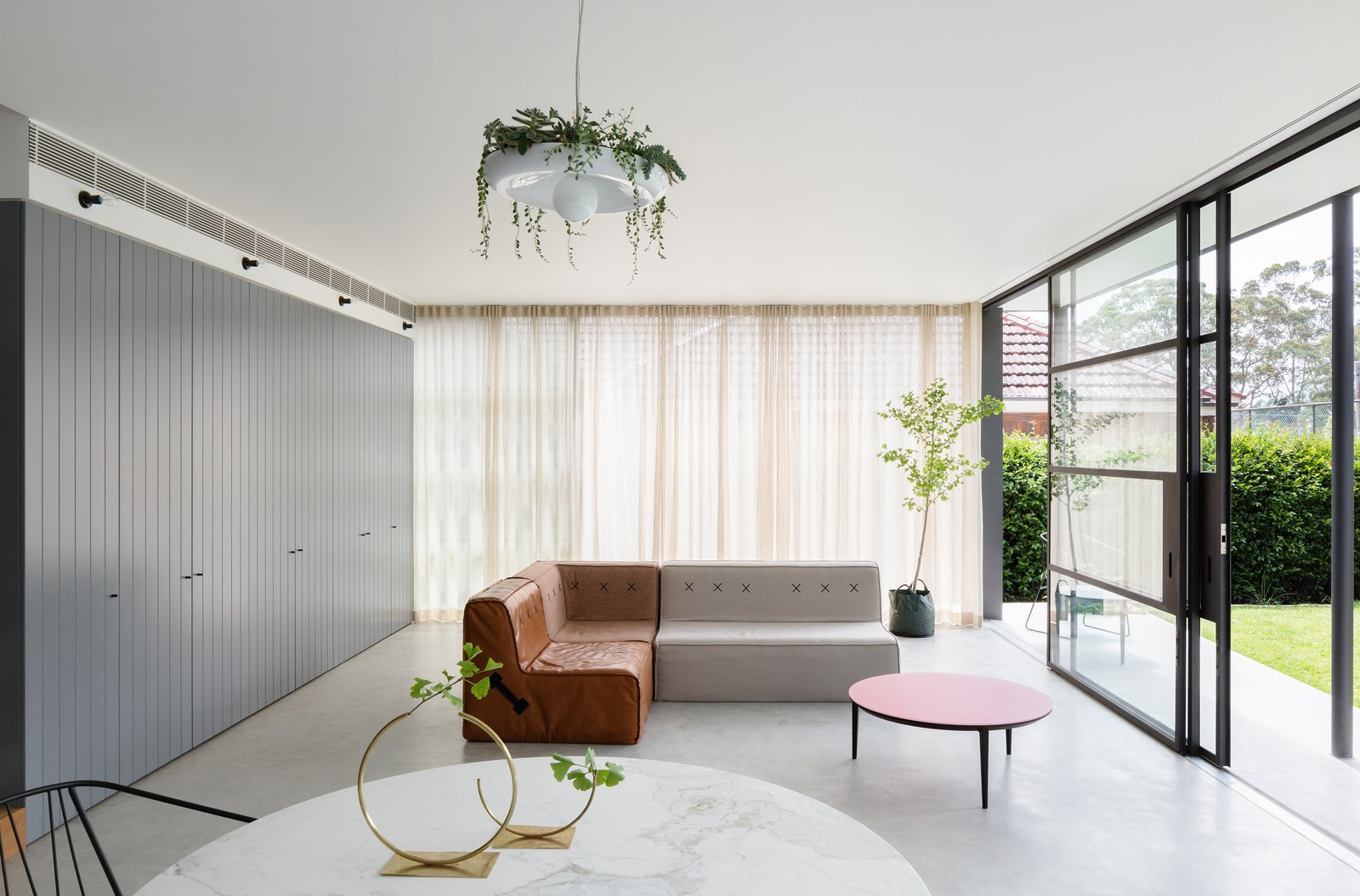 Living Room, Sofa, Coffee Tables, Ceiling Lighting, and Storage  Photo 4 of 13 in This 1930s Bungalow in Sydney Was Preserved in the Front and Updated in the Back