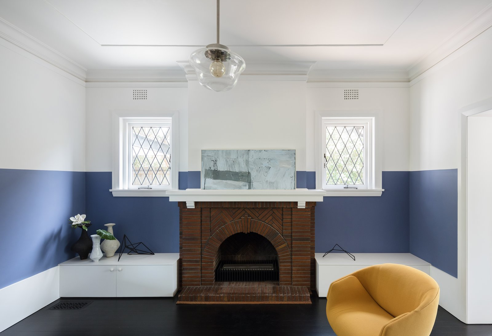 Living Room, Pendant Lighting, Chair, and Standard Layout Fireplace  Photo 5 of 13 in This 1930s Bungalow in Sydney Was Preserved in the Front and Updated in the Back