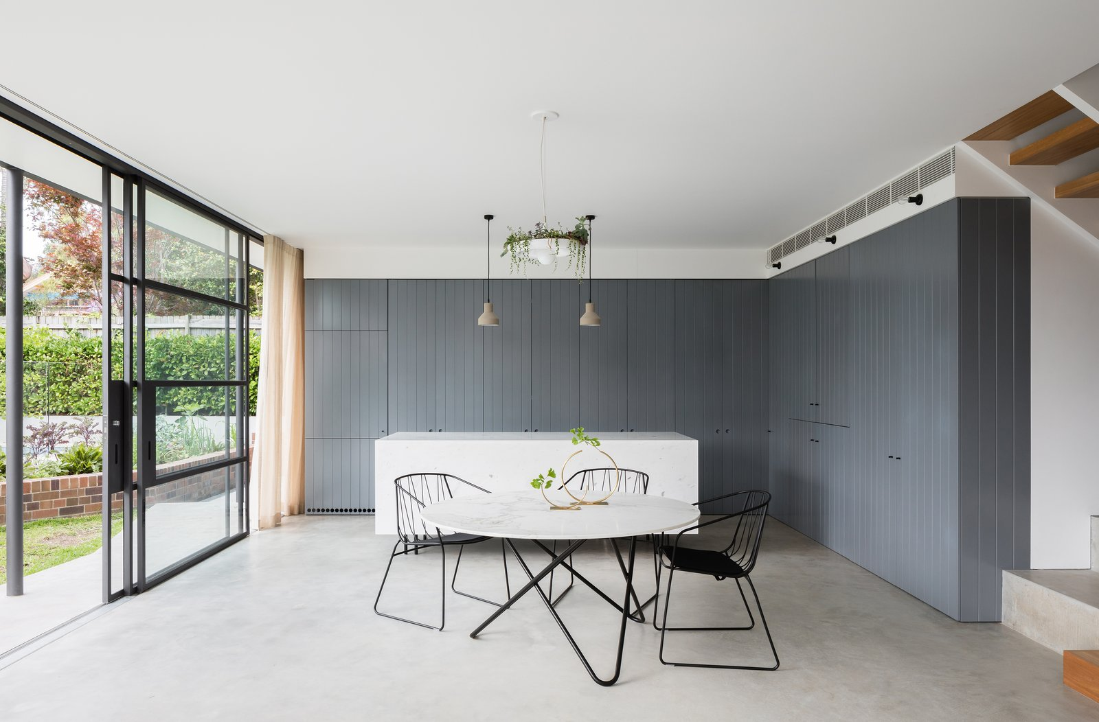 Dining Room, Chair, Table, Pendant Lighting, and Concrete Floor  Photo 7 of 13 in This 1930s Bungalow in Sydney Was Preserved in the Front and Updated in the Back