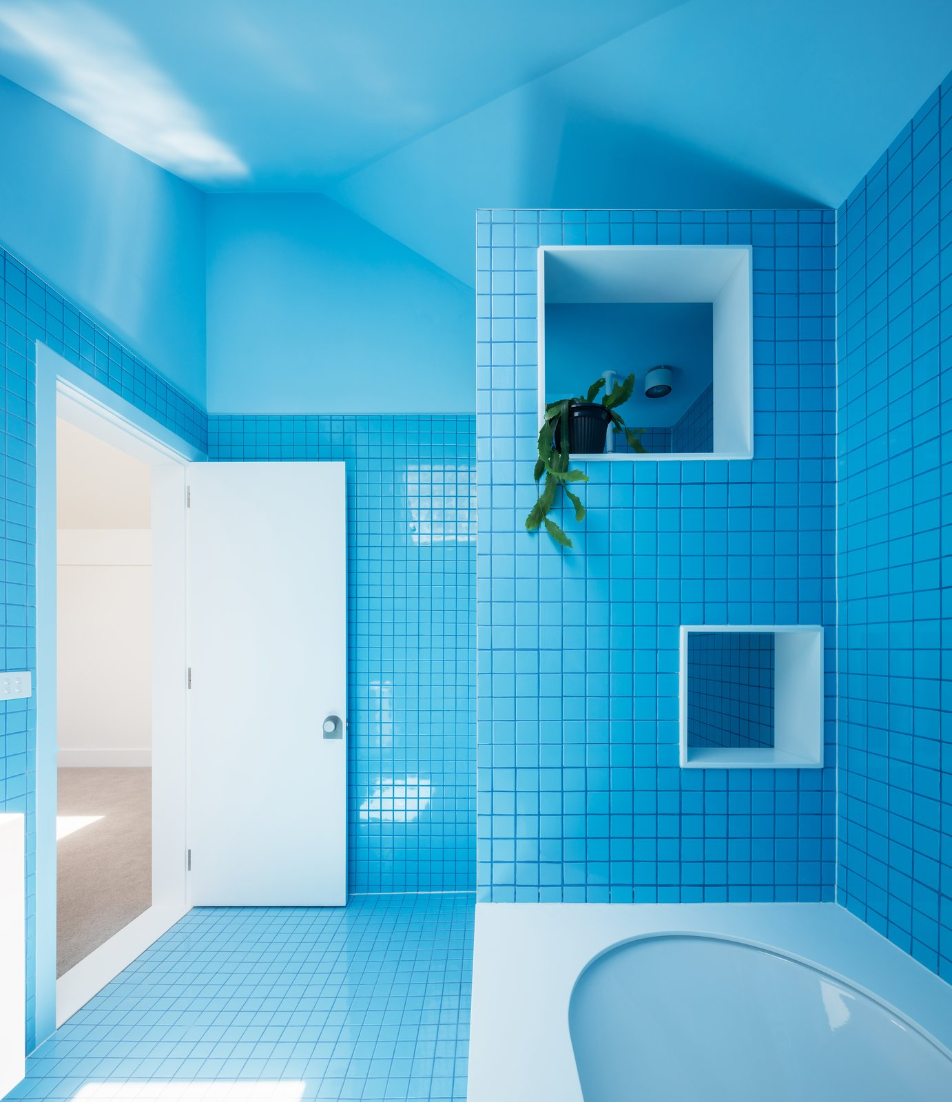 Bath Room, Porcelain Tile Floor, Drop In Tub, and Ceramic Tile Wall  Photo 12 of 13 in This 1930s Bungalow in Sydney Was Preserved in the Front and Updated in the Back