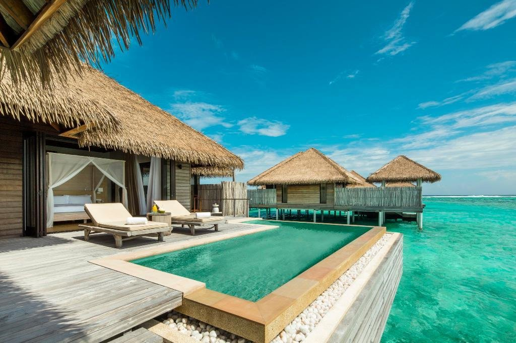 Outdoor, Plunge Pools, Tubs, Shower, and Wood Patio, Porch, Deck The 1,152 square feet overwater villas at this resort have wide doors that open to a terrace with a plunge pool facing the turquoise lagoon and their own private jetties.  Photo 3 of 9 in 9 Modern Maldivian Resorts With Spectacular Overwater Villas