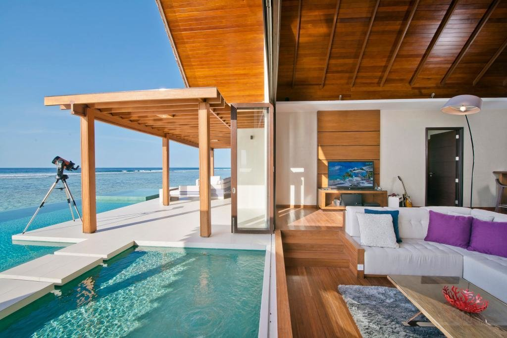 Outdoor, Infinity Pools, Tubs, Shower, and Plunge Pools, Tubs, Shower Sleek and commodious, some of the villas in this resort have indoor and outdoor showers as well a Jacuzzi that's great for a leisurely soak under the stars at night.  Photo 1 of 9 in 9 Modern Maldivian Resorts With Spectacular Overwater Villas