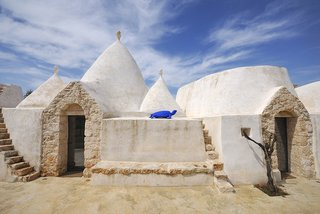 Unique to Italy's Apulia region, a trullo is an ancient hut with a conical roof that dates back to the medieval times. In the commune of Ostuni, you can stay at Brindisi Trulli, a traditional trullo structure that's been restored.