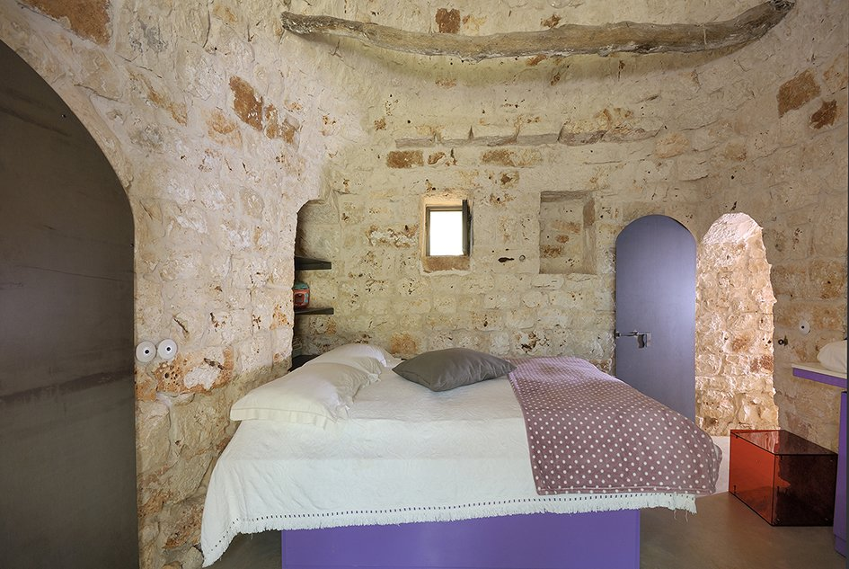 Bedroom, Bed, and Concrete Floor  Photo 8 of 11 in Ever Wanted to Stay in an Ancient Trullo in Puglia, Italy?