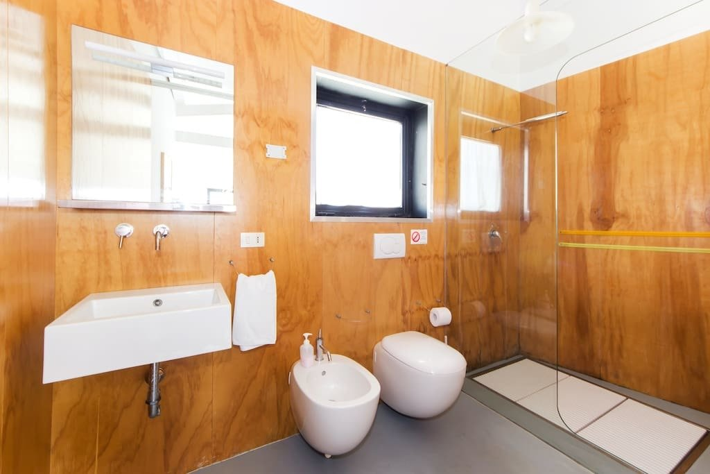 Bath Room, Ceiling Lighting, Full Shower, Wall Mount Sink, and One Piece Toilet  Photo 9 of 9 in You Can Rent This Small Sicilian Apartment For $94 a Night