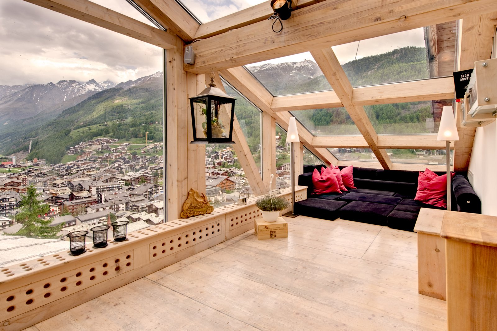 Swiss architect Heinz Julen designed this three-level Zermatt chalet-style penthouse with plenty of windows or skylights for an open and modern feel.  Photo 3 of 8 in 7 Alpine Holiday Chalets in Switzerland