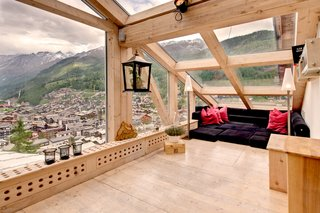 Swiss architect Heinz Julen designed this three-level Zermatt chalet-style penthouse with plenty of windows or skylights for an open and modern feel.