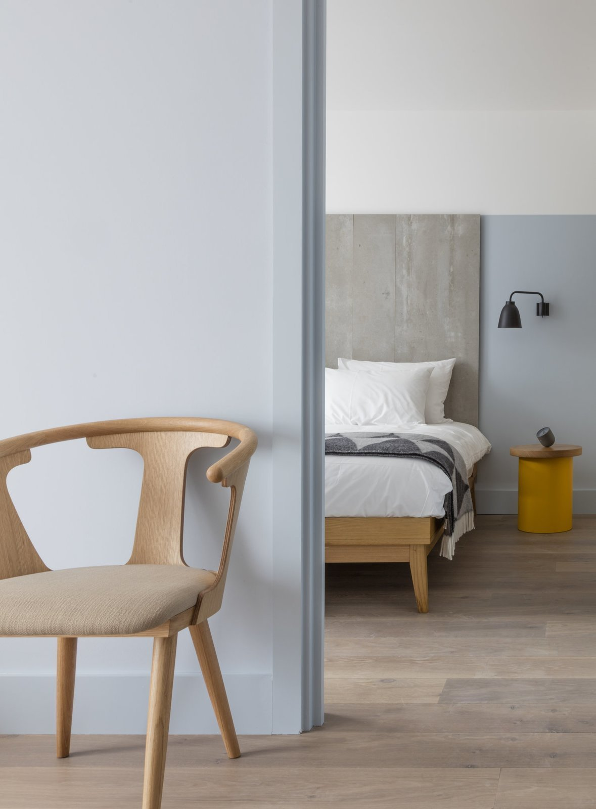Designed by Grzywinski+Pons, Leman Locke London is a service apartment style hotel that has furniture items like retractable desks and flip-up tables to make the most of space. Tagged: Bedroom, Chair, Bed, Night Stands, Wall Lighting, and Light Hardwood Floor.  Photo 8 of 9 in 8 Stylish London Apartments
