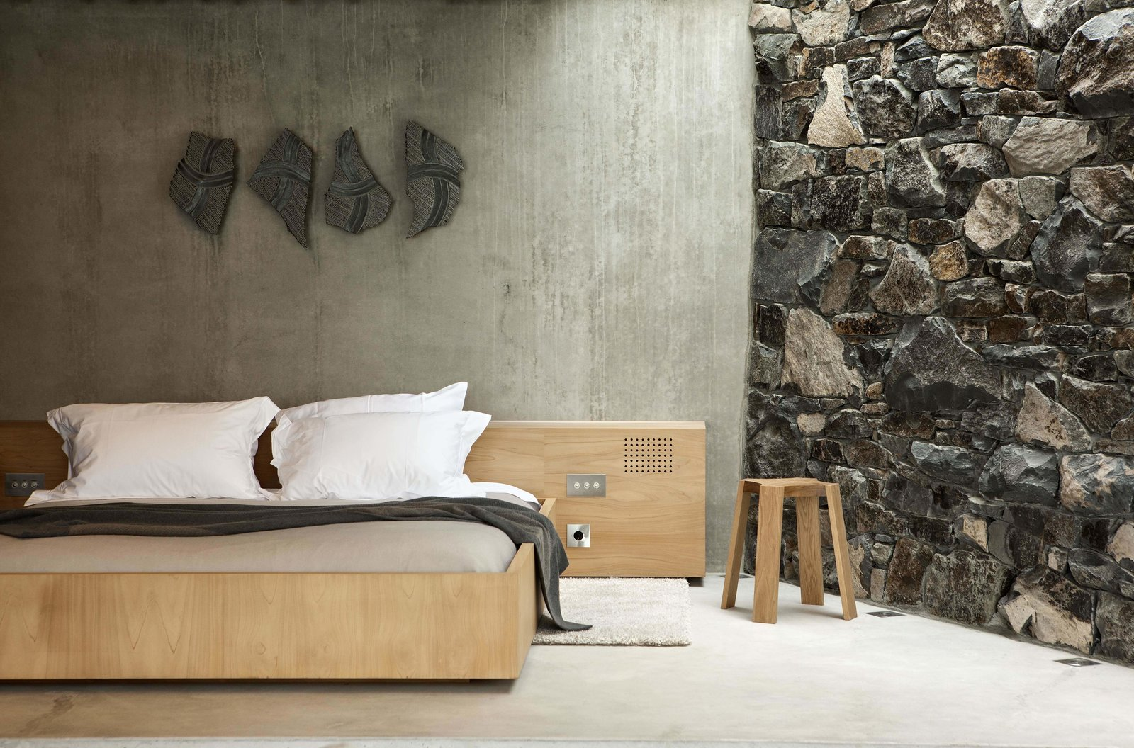 Bedroom, Bed, and Light Hardwood Floor  Photo 5 of 10 in Stay at a Stone-and-Glass Retreat in a Remote New Zealand Bay