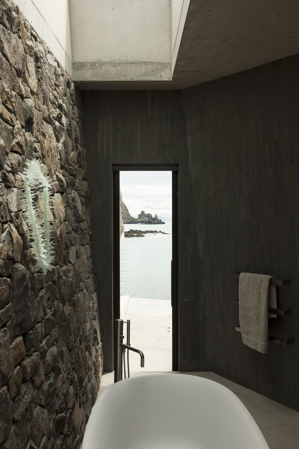 Bath Room, Freestanding Tub, and Soaking Tub  Photo 20 of 40 in 40 Modern Bathtubs That Soak In the View from Stay at a Stone-and-Glass Retreat in a Remote New Zealand Bay