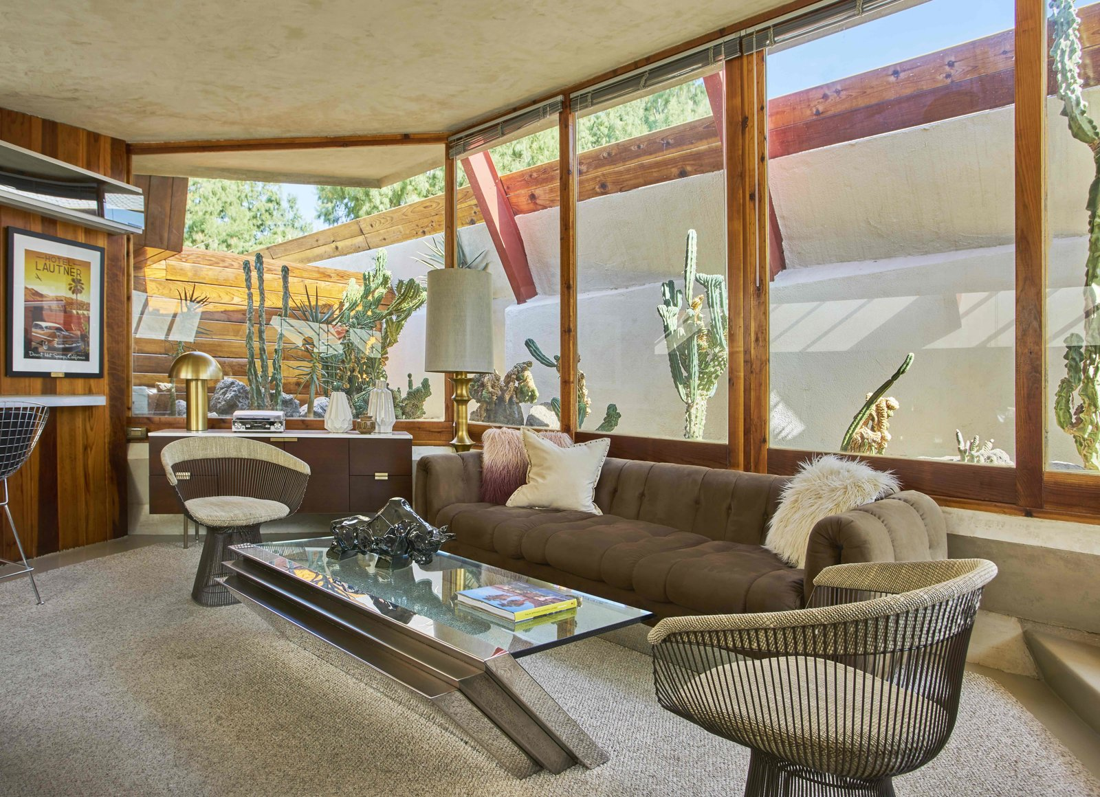 Living Room, Sofa, Table Lighting, Chair, Coffee Tables, Console Tables, Lamps, Carpet Floor, and Concrete Floor  Photo 1 of 13 in Escape to a John Lautner Micro-Resort in the Californian Desert