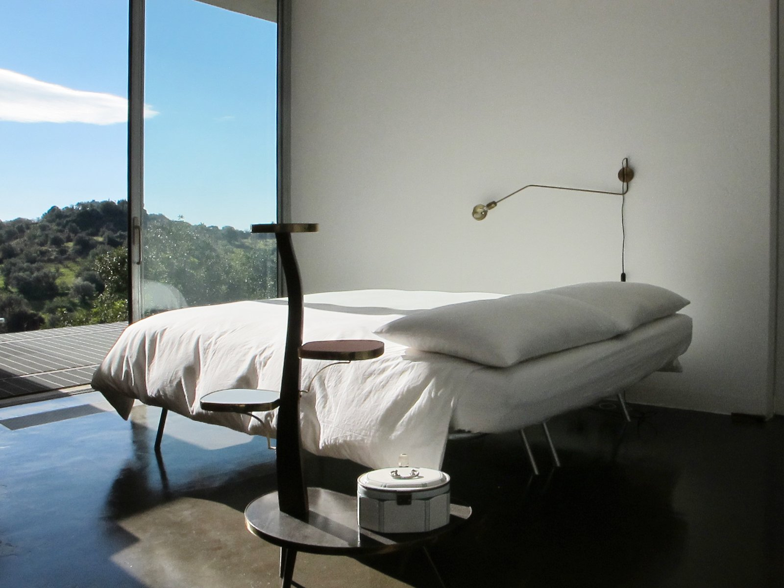 Bedroom, Bed, Wall Lighting, Night Stands, and Concrete Floor  Sea View Villa from Stay in a Minimalist Villa in the Sicilian Countryside, Complete With Sea Views
