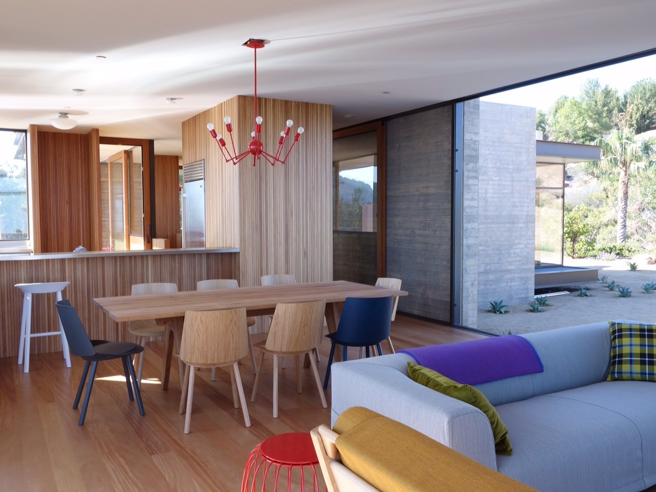 Dining Room, Medium Hardwood Floor, and Accent Lighting  Photo 3 of 13 in Take Your Next Vacation in a Midcentury Home in the Santa Monica Mountains
