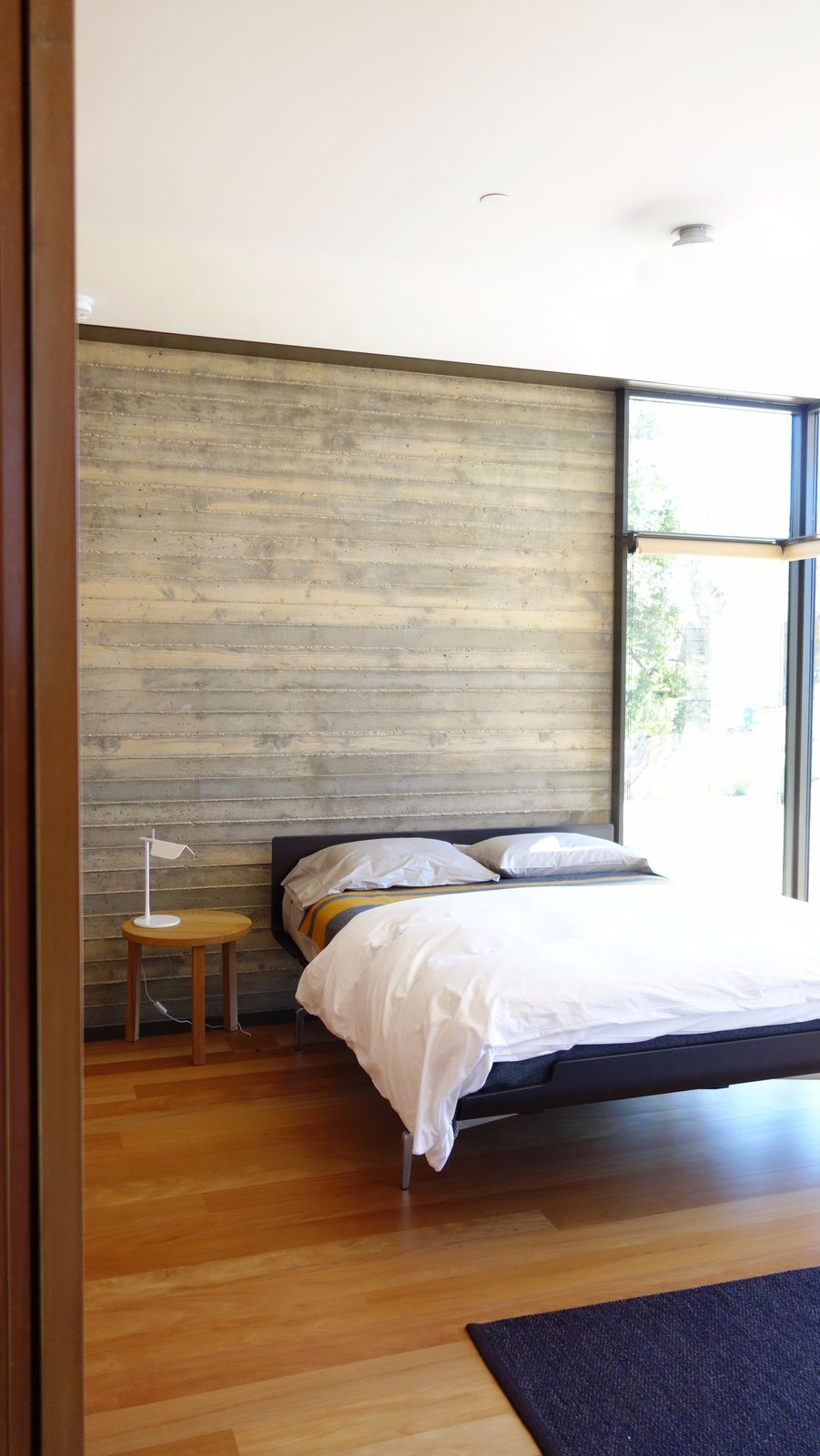 Bedroom, Bed, Night Stands, and Medium Hardwood Floor  Photo 8 of 13 in Take Your Next Vacation in a Midcentury Home in the Santa Monica Mountains