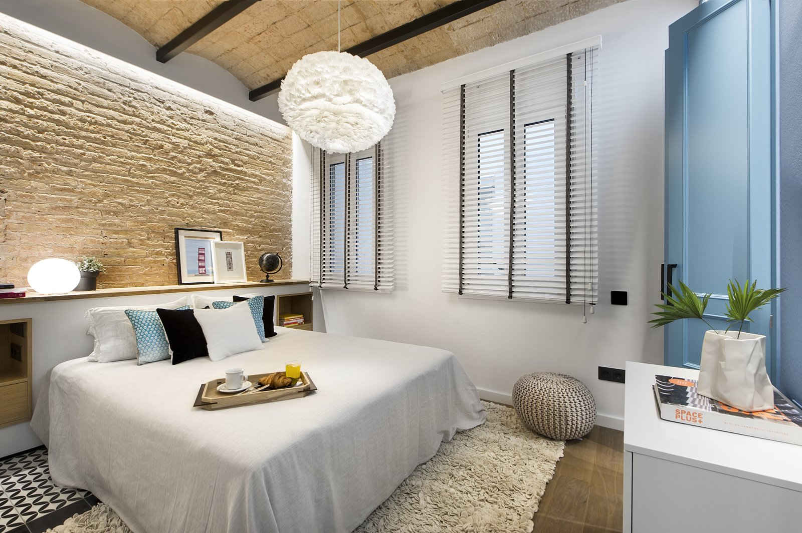 Bedroom, Bed, Dresser, Storage, Pendant Lighting, Medium Hardwood Floor, and Ceramic Tile Floor  Best Photos from A Smart Layout Maximizes Space in This Compact Urban Beach Apartment in Barcelona