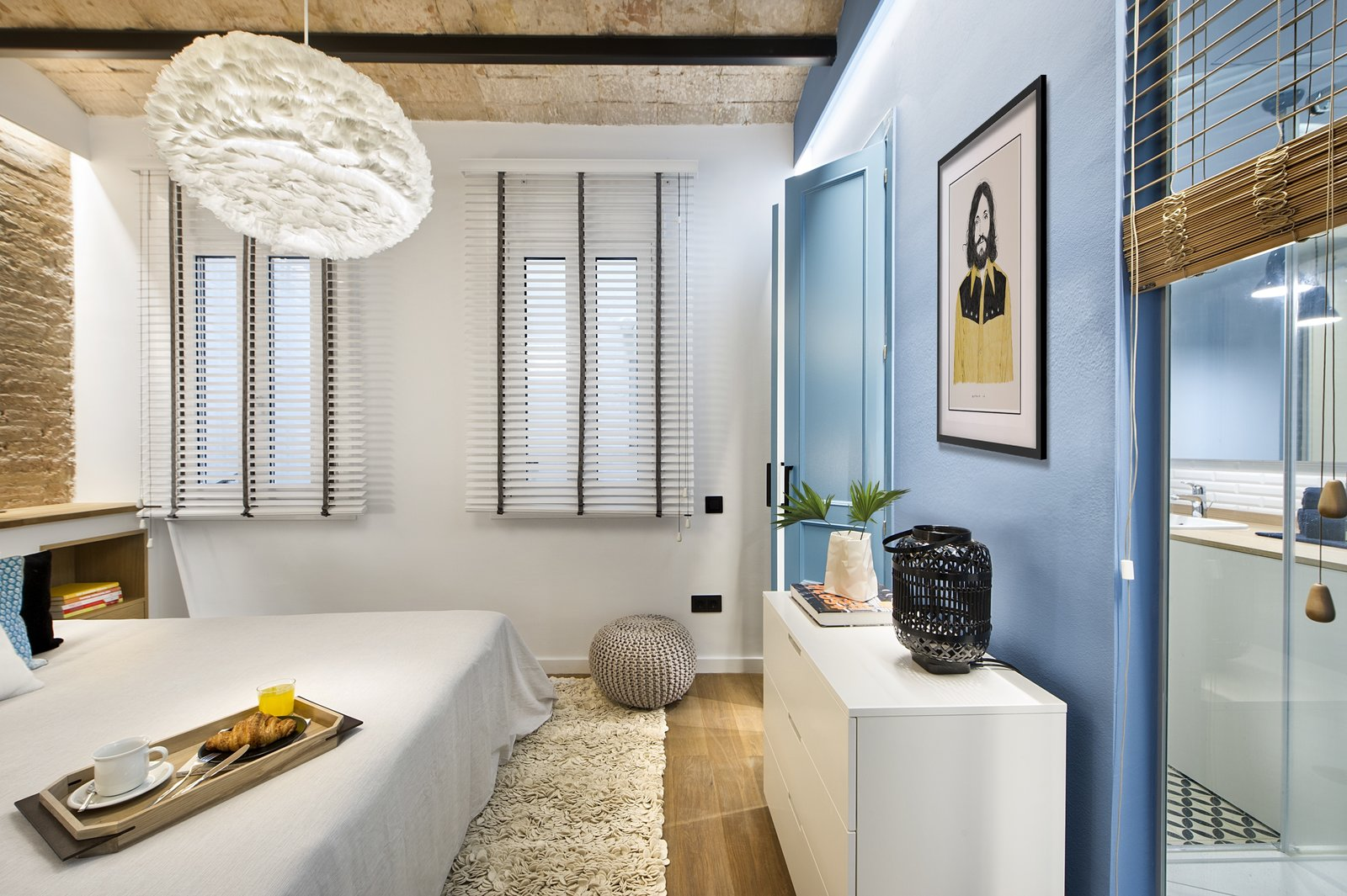 Bedroom, Bed, Shelves, Dresser, Pendant Lighting, and Light Hardwood Floor  Photo 11 of 11 in A Smart Layout Maximizes Space in This Compact Urban Beach Apartment in Barcelona