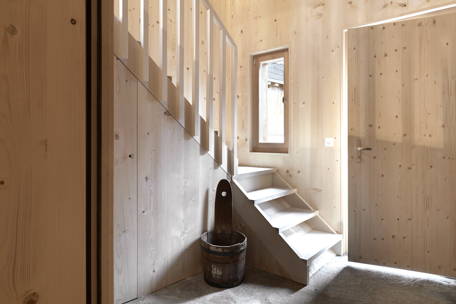 Tagged: Staircase, Wood Tread, and Wood Railing.  Photo 7 of 13 in A Renovated Pagan House in the Swiss Alps Puts Guests in Touch With the Past