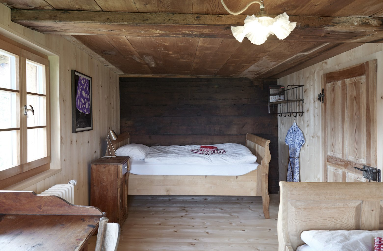 Bedroom, Night Stands, and Bed  Photo 8 of 13 in A Renovated Pagan House in the Swiss Alps Puts Guests in Touch With the Past