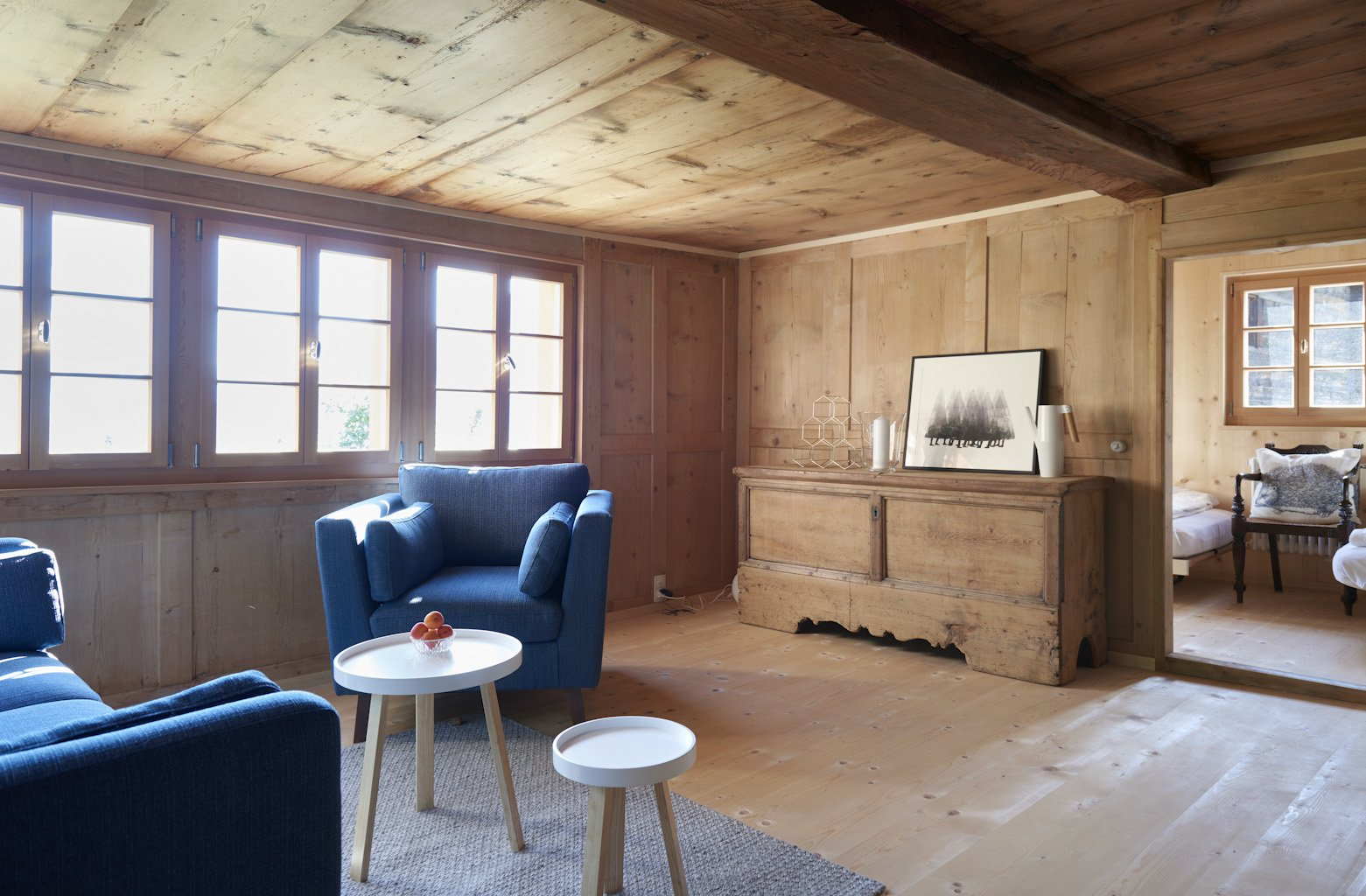 Living Room, Console Tables, Sofa, Chair, Light Hardwood Floor, and Coffee Tables  Photo 10 of 13 in A Renovated Pagan House in the Swiss Alps Puts Guests in Touch With the Past
