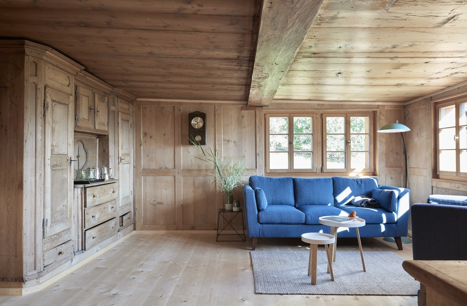 Living Room, Light Hardwood Floor, Sofa, and End Tables  Photo 4 of 13 in A Renovated Pagan House in the Swiss Alps Puts Guests in Touch With the Past
