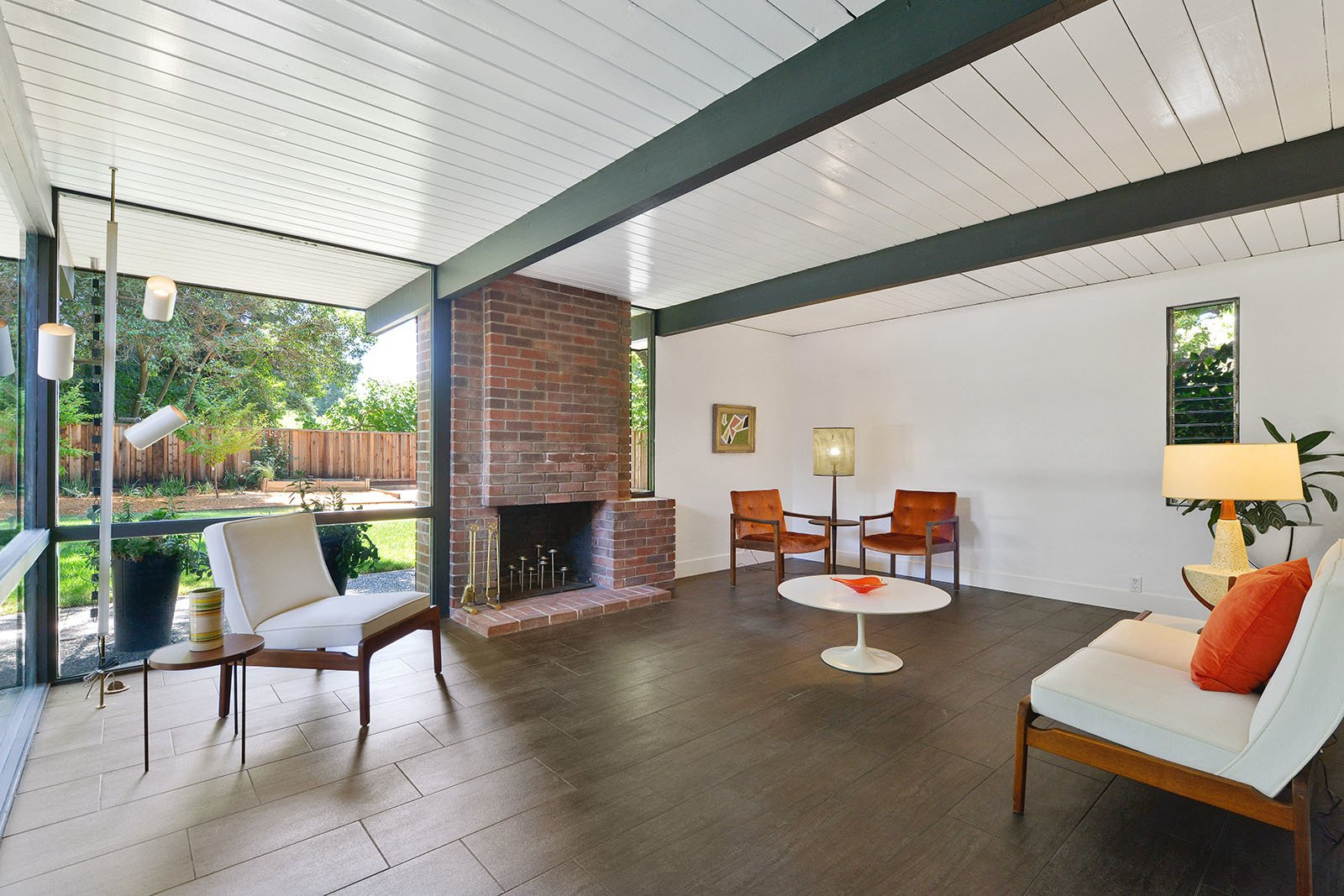 Living Room, Standard Layout Fireplace, and Wood Burning Fireplace  Photo 4 of 15 in An Enormous Bay Area Eichler Asks $1.45M