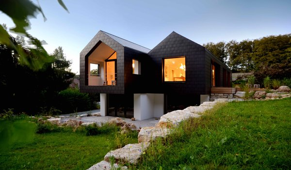 Exterior, Metal Siding Material, Gable RoofLine, House Building Type, Cabin Building Type, and Metal Roof Material  Refugium Betzenstein from Escape to a Bio-Passive Vacation Refuge in a Bavarian Nature Park