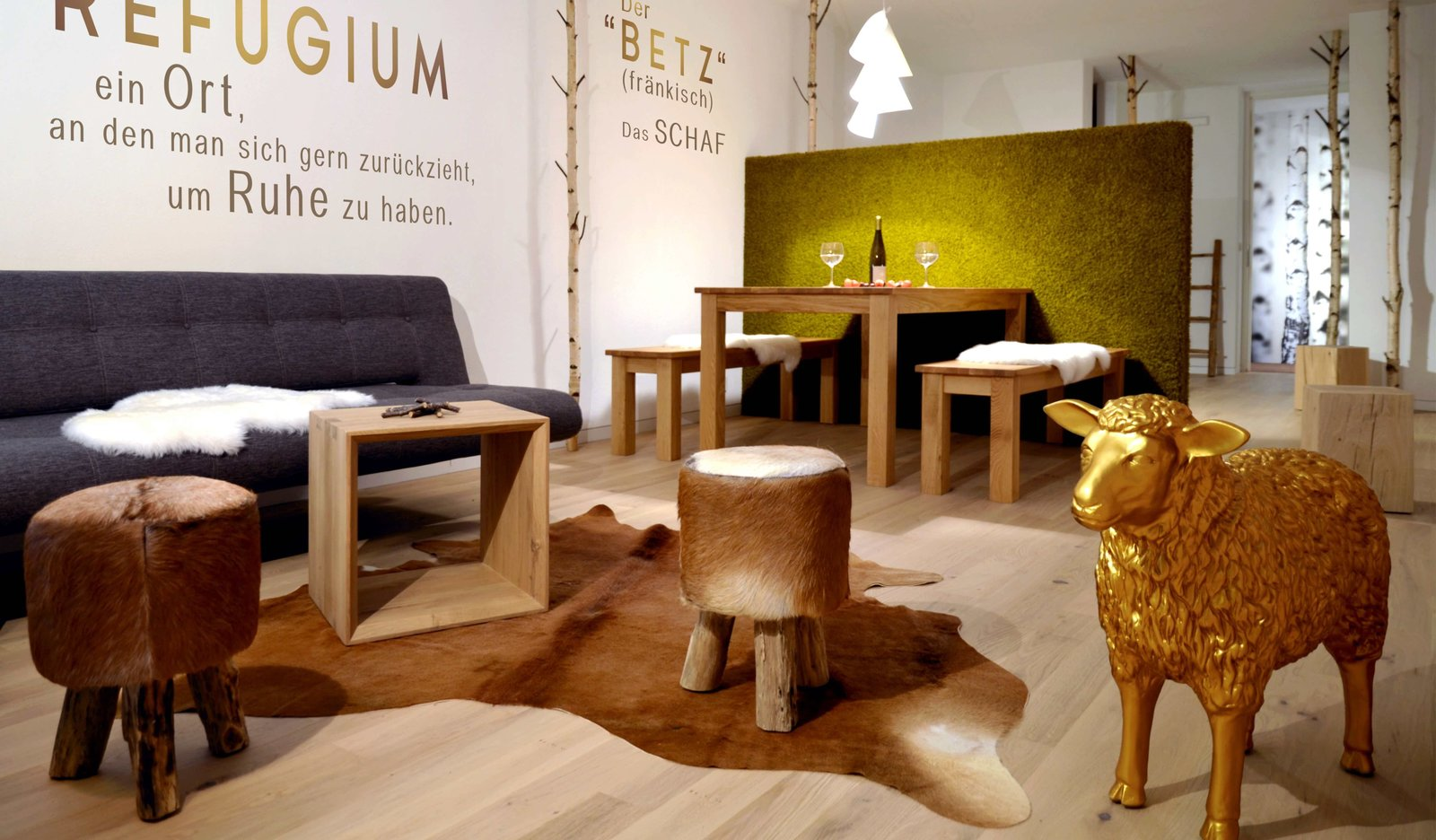 Living Room, Stools, Sofa, Bench, Table, Pendant Lighting, and Light Hardwood Floor  Refugium Betzenstein from Escape to a Bio-Passive Vacation Refuge in a Bavarian Nature Park