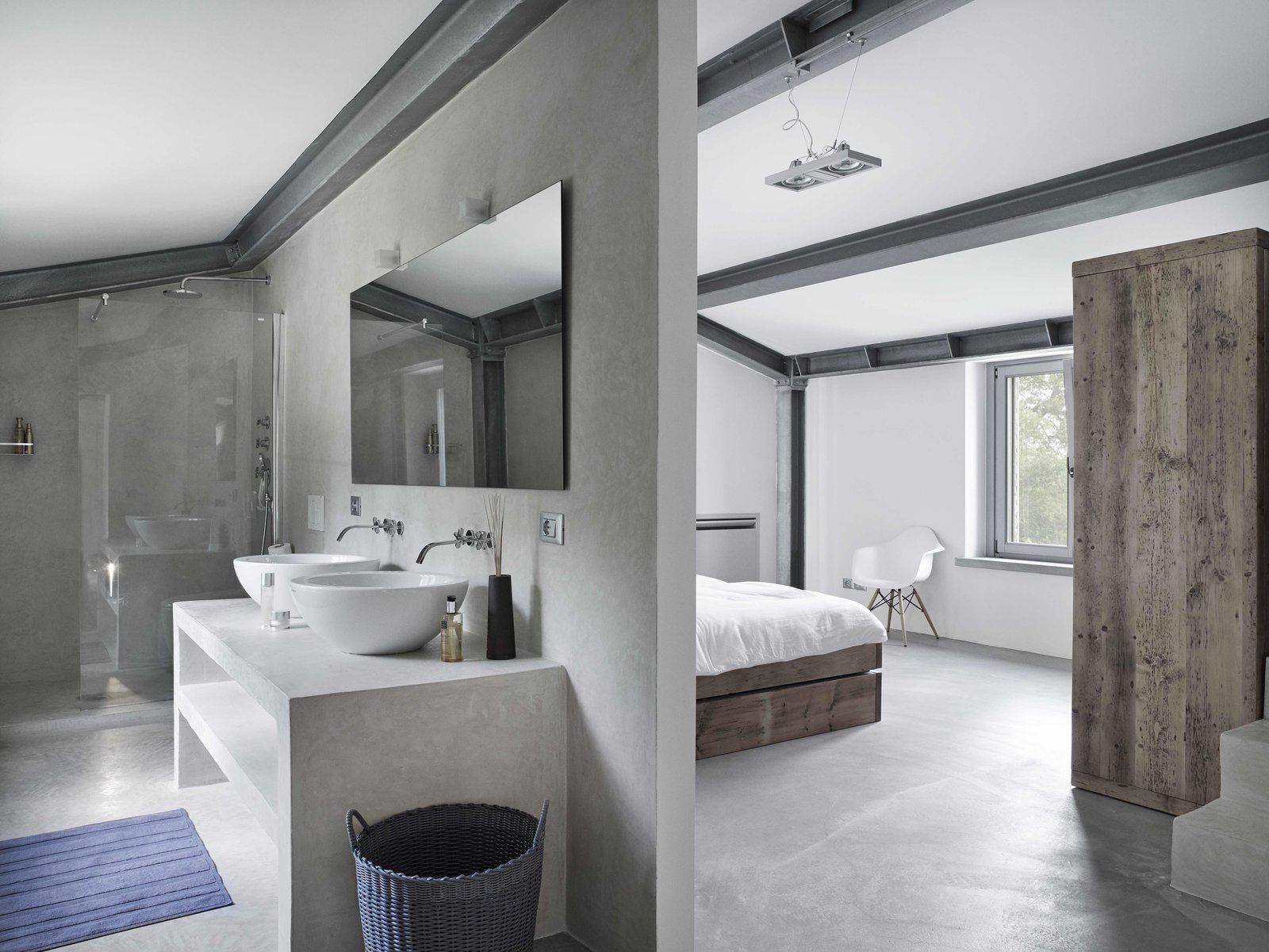 Bath Room, Concrete Counter, Concrete Floor, Vessel Sink, Enclosed Shower, Concrete Wall, Corner Shower, Wall Lighting, and Pendant Lighting  Photo 8 of 11 in Stay in a Modern, Industrial Home That's Hidden Inside a Traditional Tuscan Villa