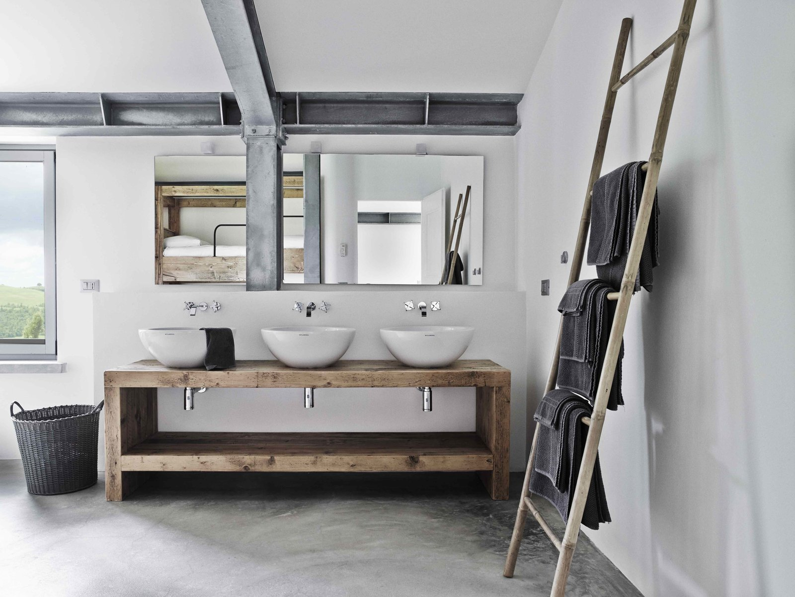 Bath Room, Wood Counter, Concrete Floor, Vessel Sink, and Wall Lighting  Photo 9 of 11 in Stay in a Modern, Industrial Home That's Hidden Inside a Traditional Tuscan Villa