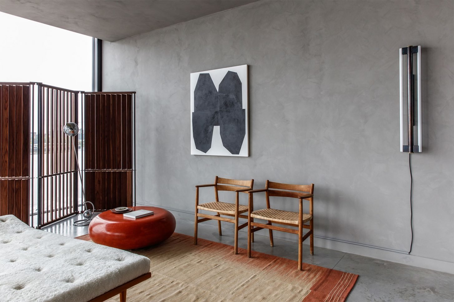 Living Room, Ottomans, Chair, Recliner, Accent Lighting, Wall Lighting, and Concrete Floor  Photo 13 of 13 in For Just Under $2 Million, You Could Live in a London Penthouse Outfitted by Cereal Magazine