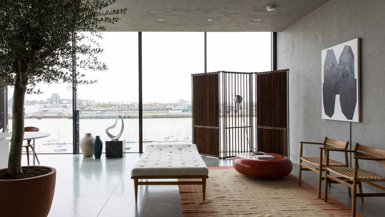 Living Room, Chair, Recliner, Recessed Lighting, and Concrete Floor  Photo 5 of 13 in For Just Under $2 Million, You Could Live in a London Penthouse Outfitted by Cereal Magazine