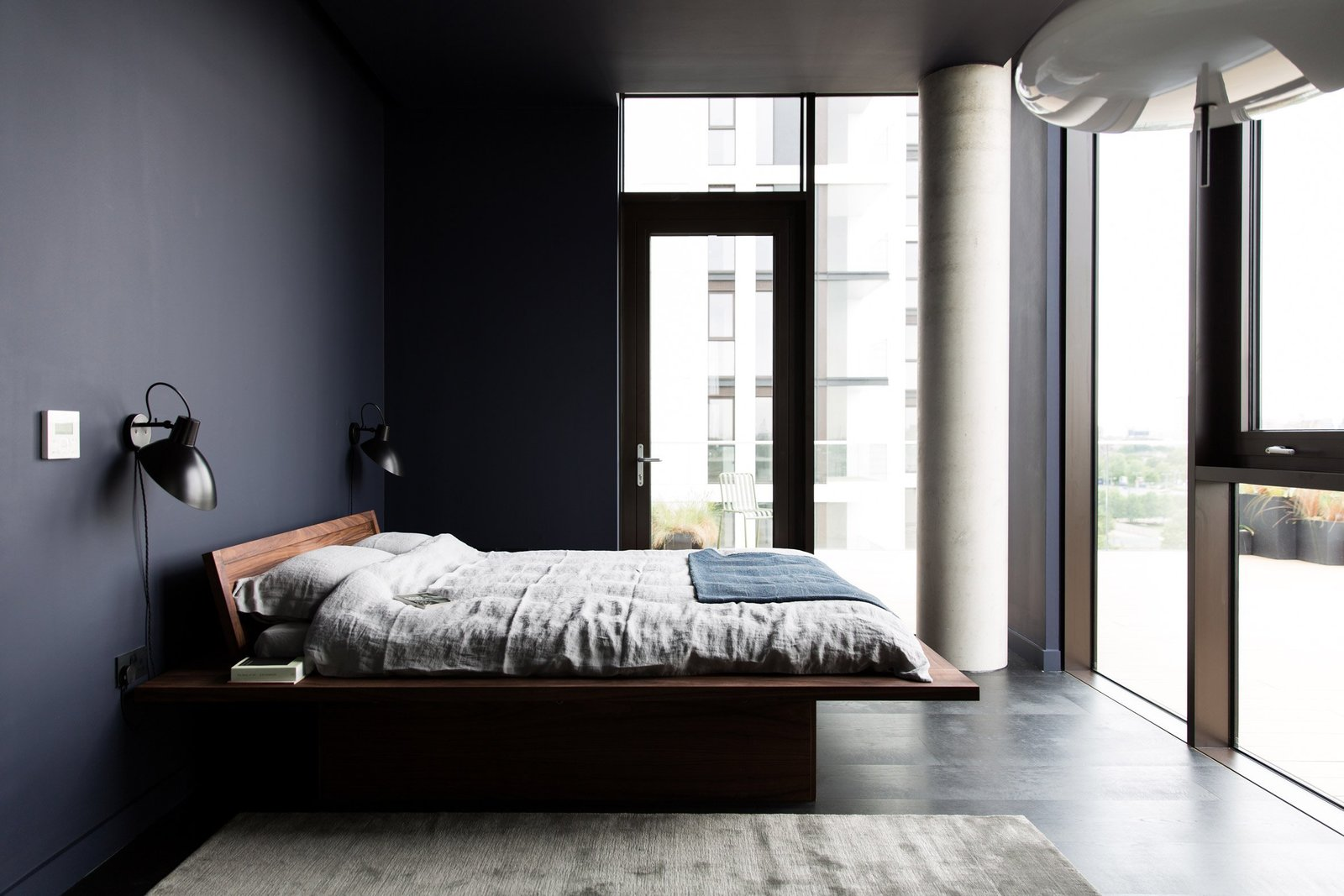 Bedroom, Bed, Wall Lighting, and Dark Hardwood Floor  Photo 8 of 13 in For Just Under $2 Million, You Could Live in a London Penthouse Outfitted by Cereal Magazine