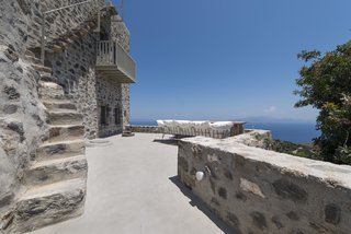 Stay at a Greek Island Villa Among the Ruins of a 14th-Century Castle - Photo 1 of 12 -