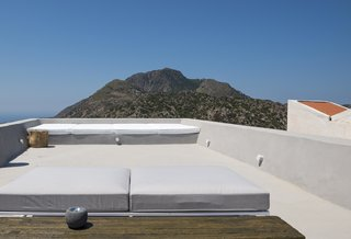 Stay at a Greek Island Villa Among the Ruins of a 14th-Century Castle - Photo 11 of 12 -