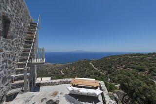 Stay at a Greek Island Villa Among the Ruins of a 14th-Century Castle - Photo 12 of 12 -