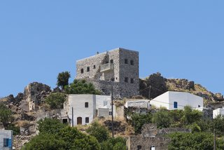Stay at a Greek Island Villa Among the Ruins of a 14th-Century Castle - Photo 2 of 12 -