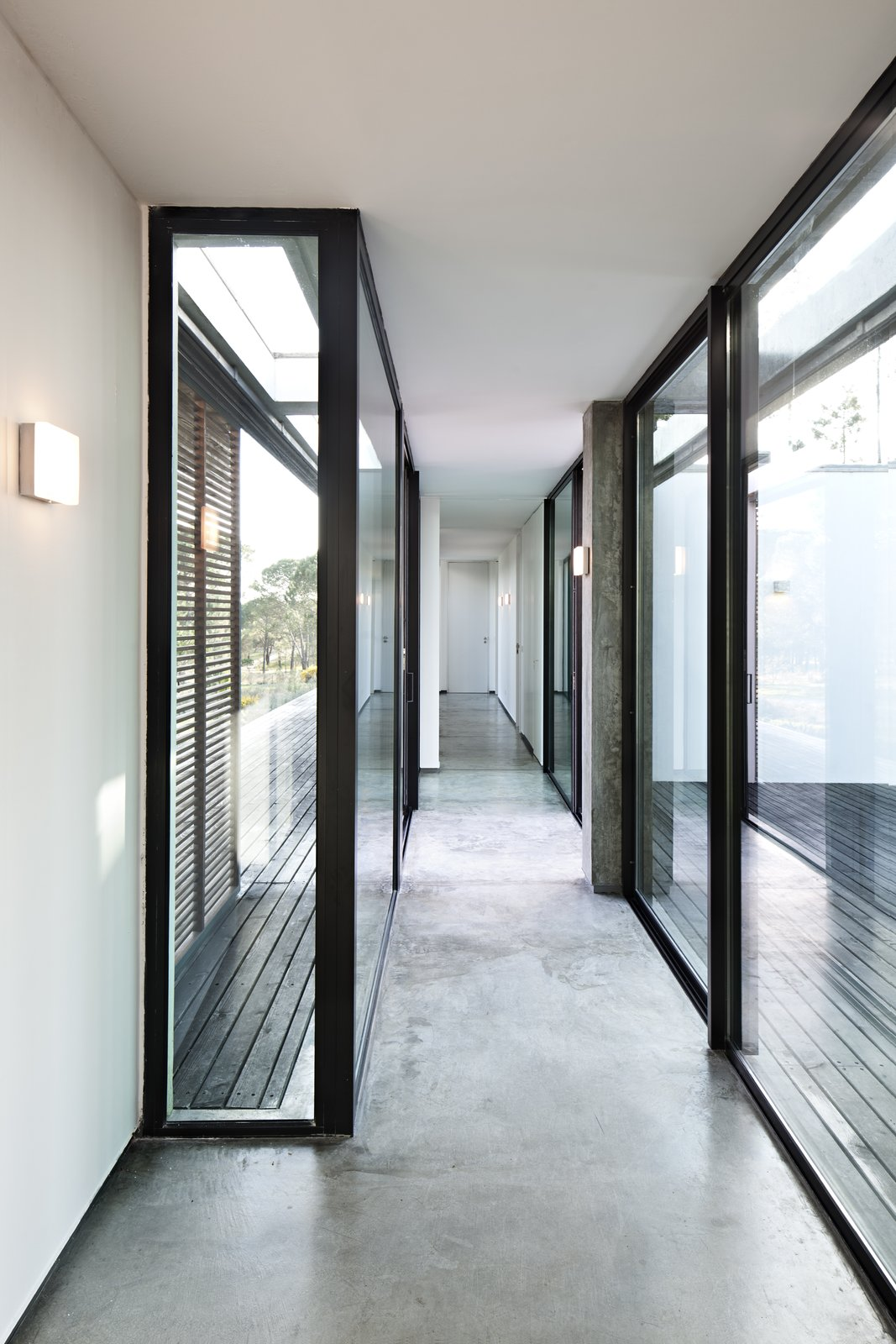Hallway and Concrete Floor  Photo 5 of 15 in Escape to a Light-Filled, Beach-Meets-Forest Retreat in Portugal