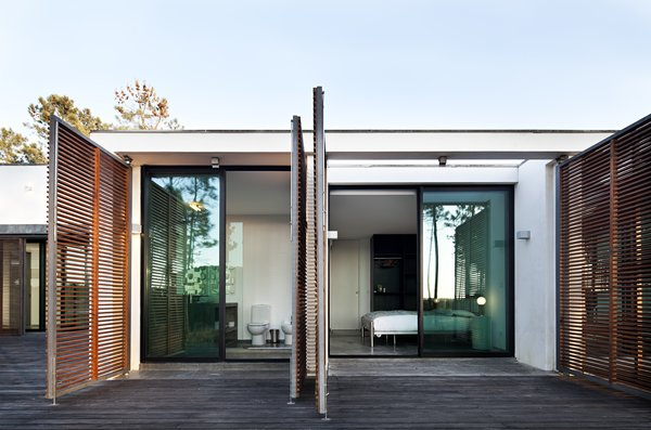 Side Yard, Wood, Doors, Exterior, Swing, Wood, Sliding, and Metal  Best Doors Swing Sliding Photos from Escape to a Light-Filled, Beach-Meets-Forest Retreat in Portugal