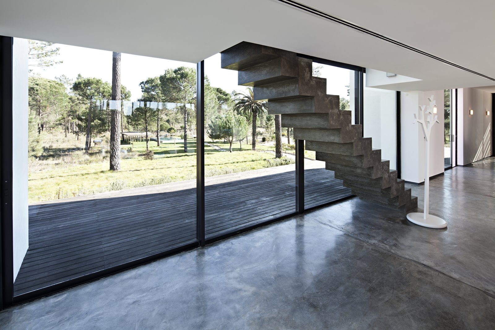 Staircase and Concrete Tread  Photo 11 of 15 in Escape to a Light-Filled, Beach-Meets-Forest Retreat in Portugal