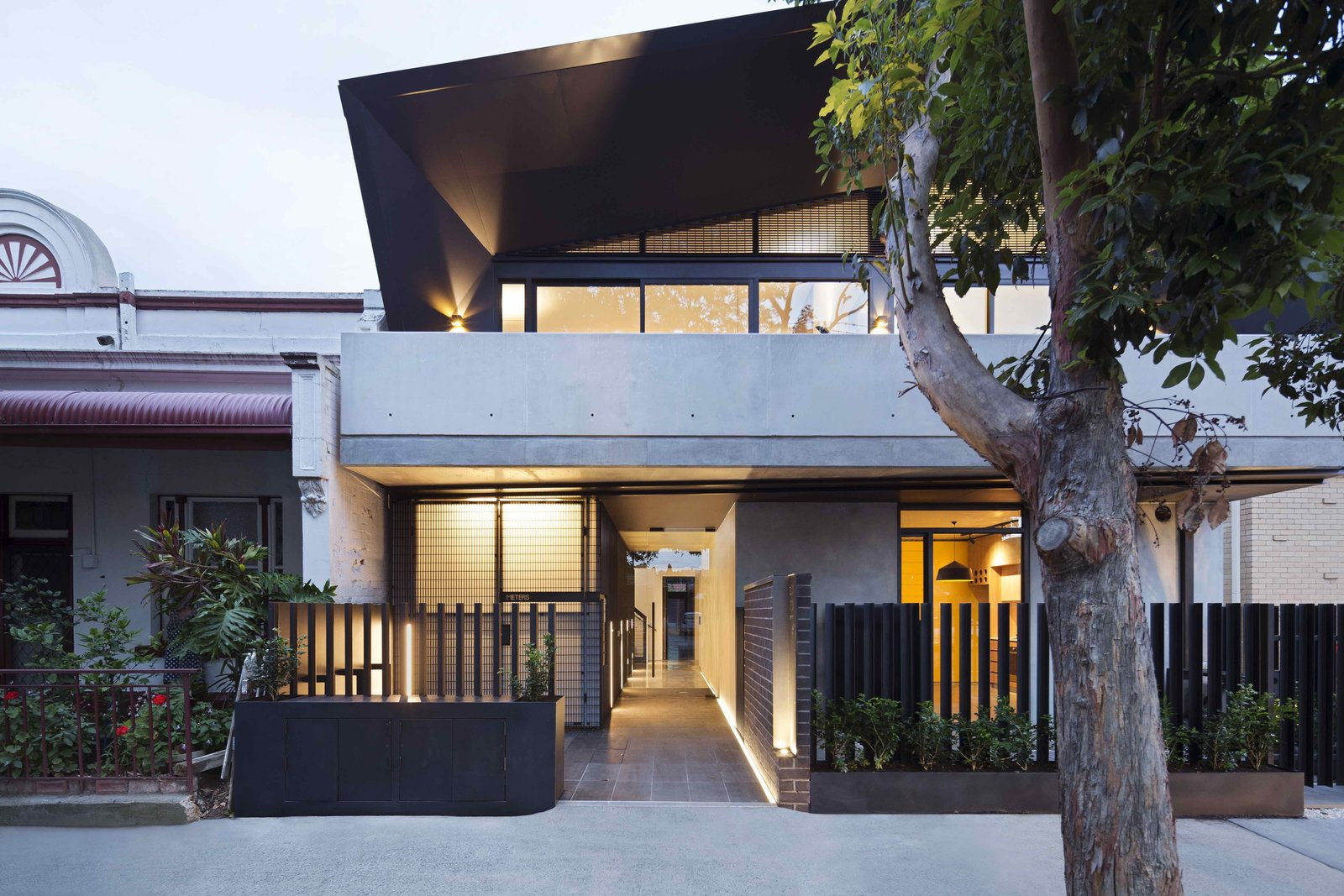 Outdoor, Gardens, Front Yard, Small Patio, Porch, Deck, Trees, and Metal Fences, Wall  Photo 1 of 14 in What Looks Like a Single Dwelling in Melbourne Actually Holds Six Walk-Up Apartments