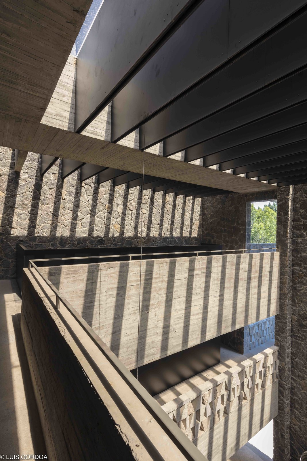 Hallway To take full advantage of Jiutepec's year-round warm weather, plenty of open-air patios are incorporated into the design.  Photo 7 of 12 in A New Hotel in Morelos Combines Local Mexican Elements With Brutalist Architecture