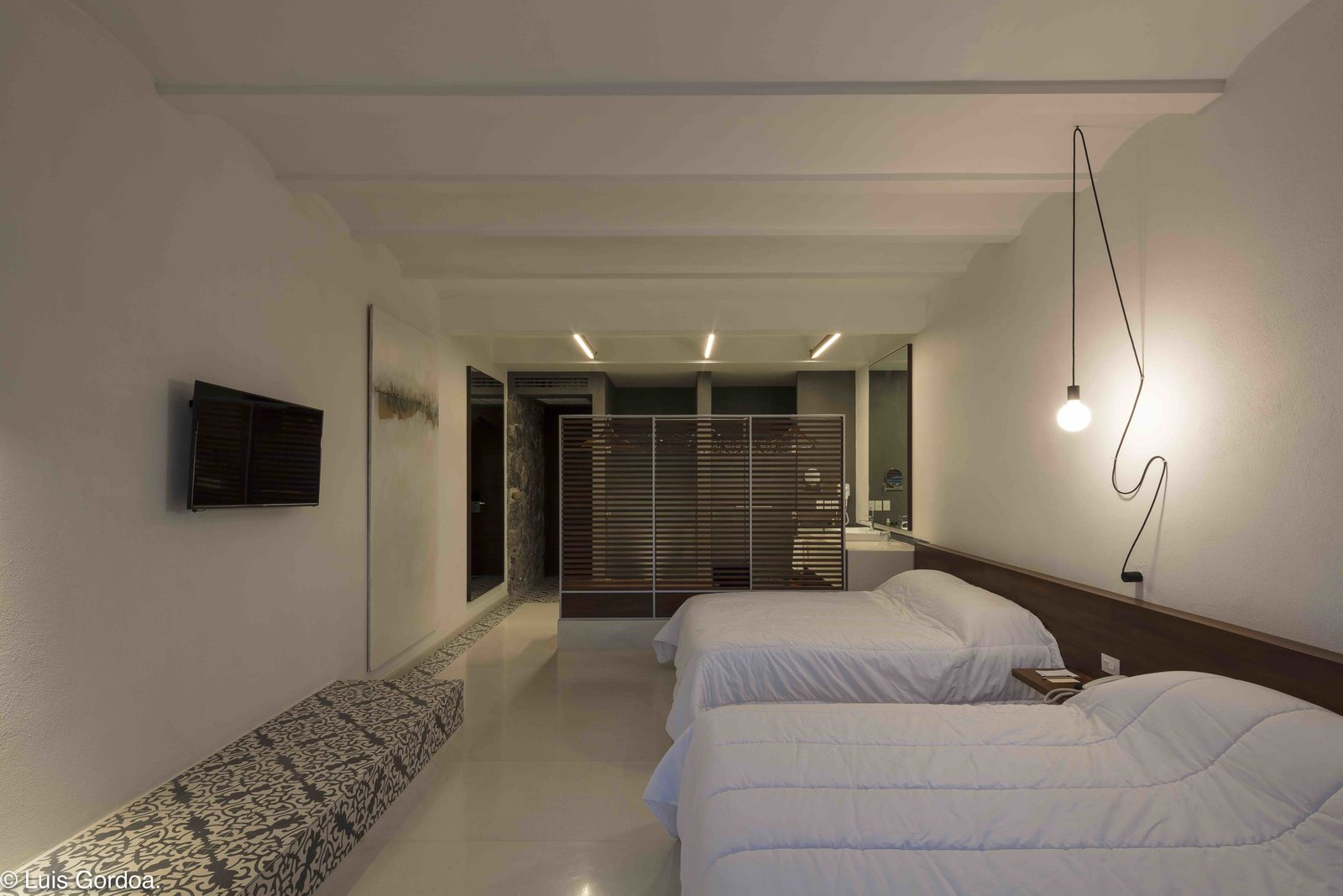 Bedroom, Pendant Lighting, and Bed  Photo 10 of 12 in A New Hotel in Morelos Combines Local Mexican Elements With Brutalist Architecture