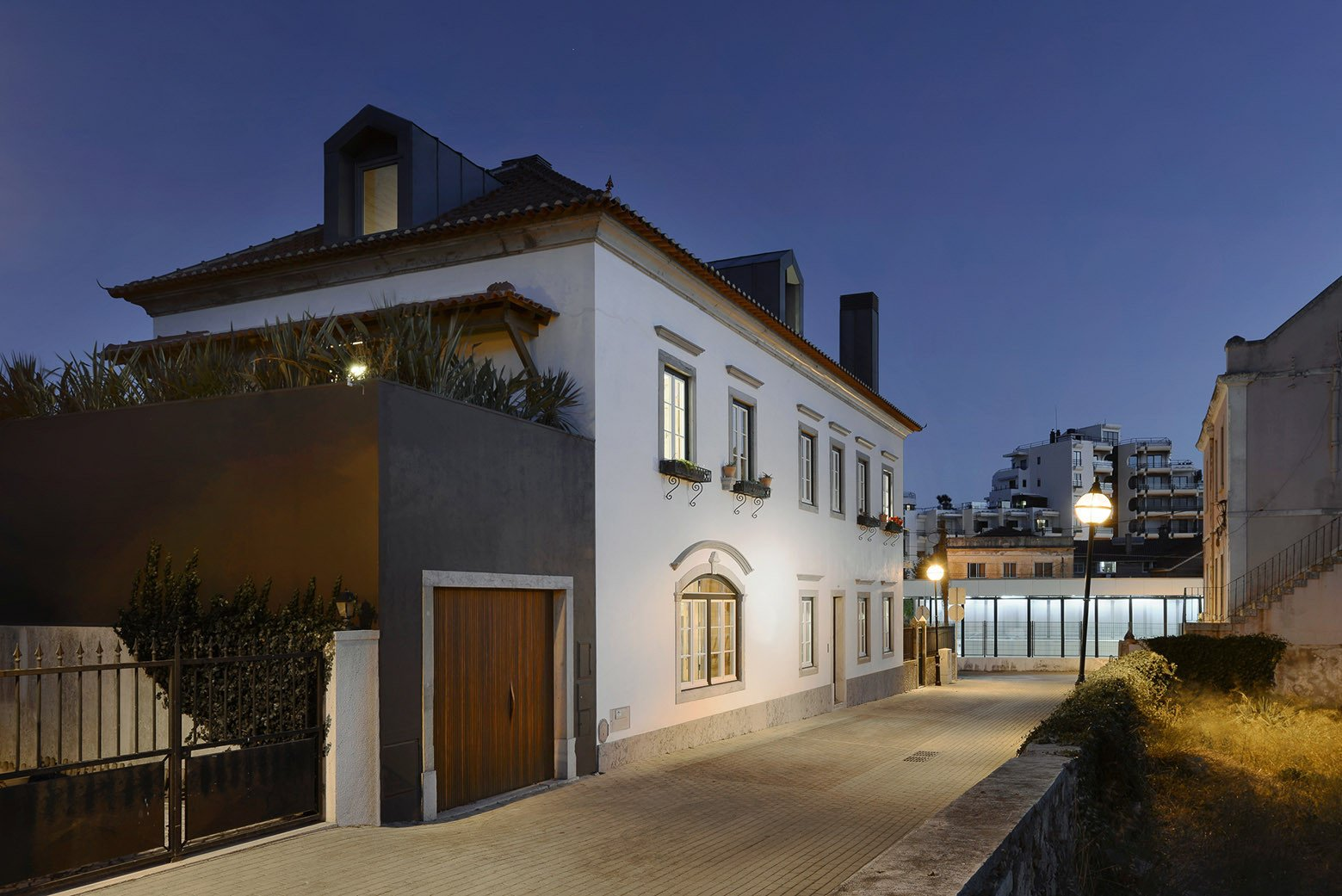 Outdoor, Front Yard, Metal Fences, Wall, Hardscapes, and Walkways  Photo 2 of 16 in An Architect Renovates His 1920s Home in Portugal, While Preserving the Exterior Shell