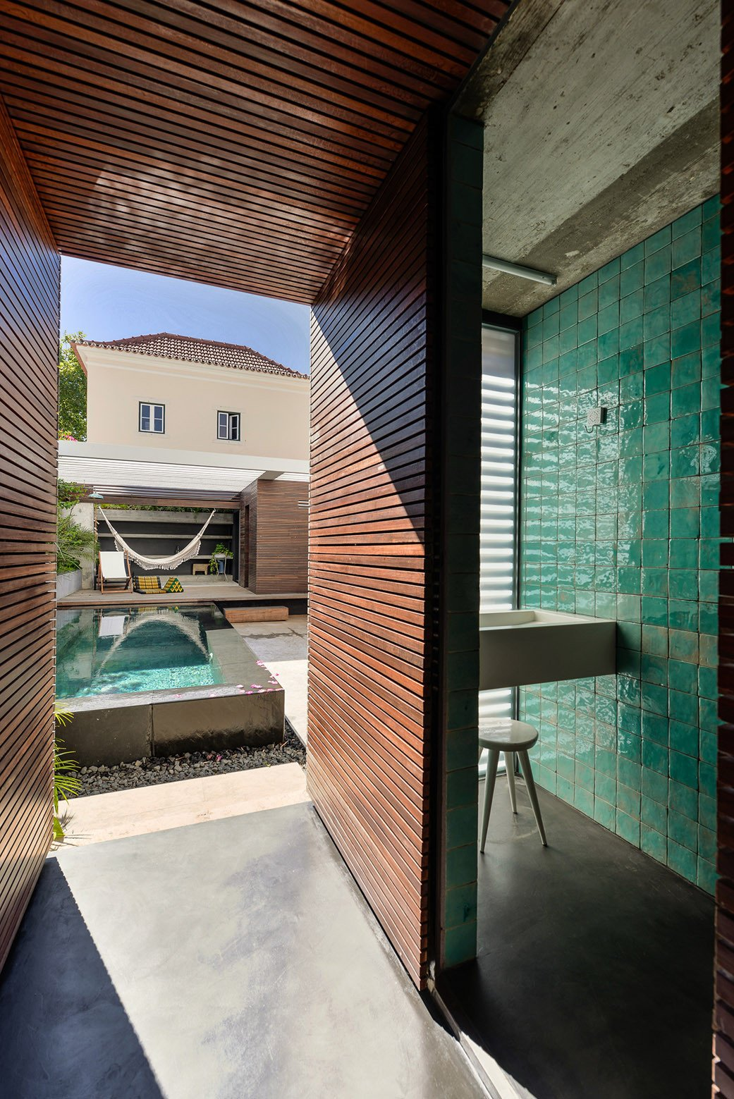 Outdoor, Decking Patio, Porch, Deck, Small Pools, Tubs, Shower, and Back Yard  Photo 9 of 16 in An Architect Renovates His 1920s Home in Portugal, While Preserving the Exterior Shell