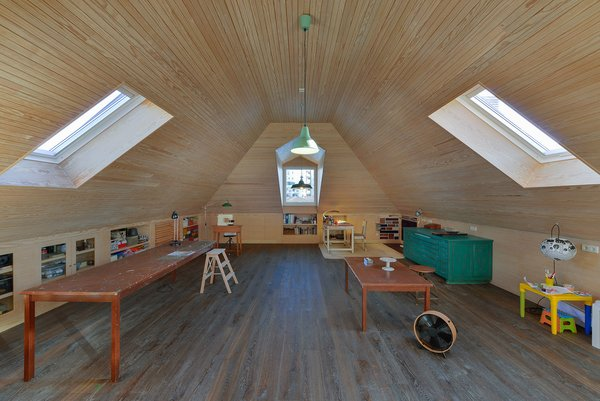 Kids Room, Family Room Room Type, Dresser, Desk, Shelves, Medium Hardwood Floor, Neutral Gender, and Storage  Photo 12 of 16 in An Architect Renovates His 1920s Home in Portugal, While Preserving the Exterior Shell
