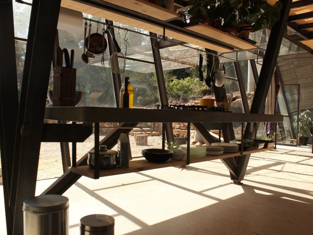 Kitchen, Concrete Counter, and Range  Photo 7 of 8 in Stay in a Domed, Glass-Front Vacation Home in a Spanish Forest